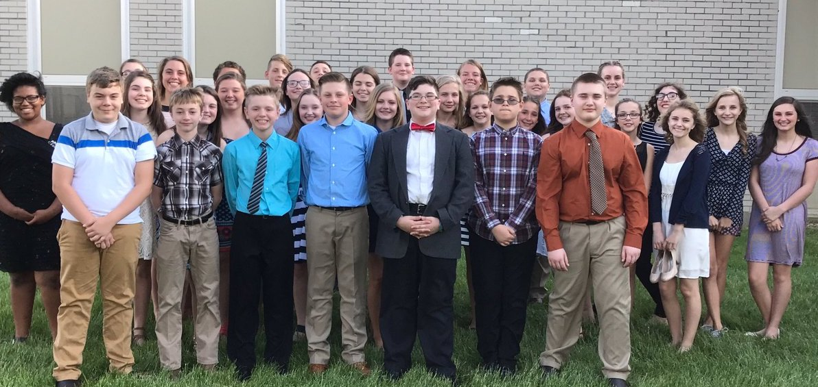 students standing together on the day they were inducted into the National Junior Honor Society
