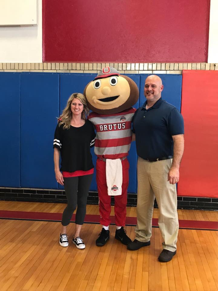Mrs. Martindale and Mr. Coffey posing with Brutus Buckeye