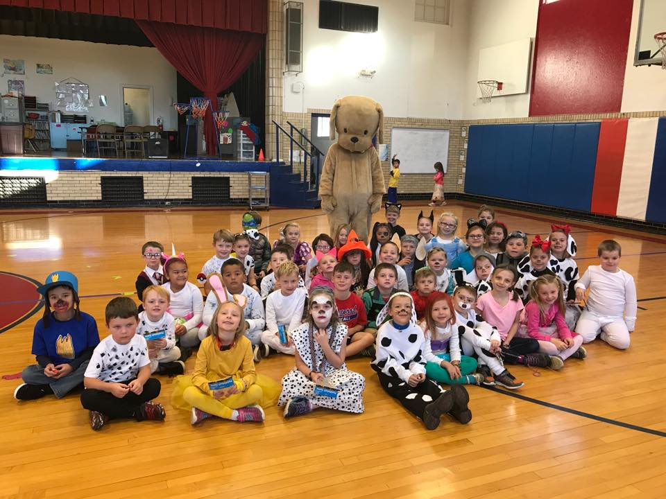group of elementary students in costume posed for recognition of their reading