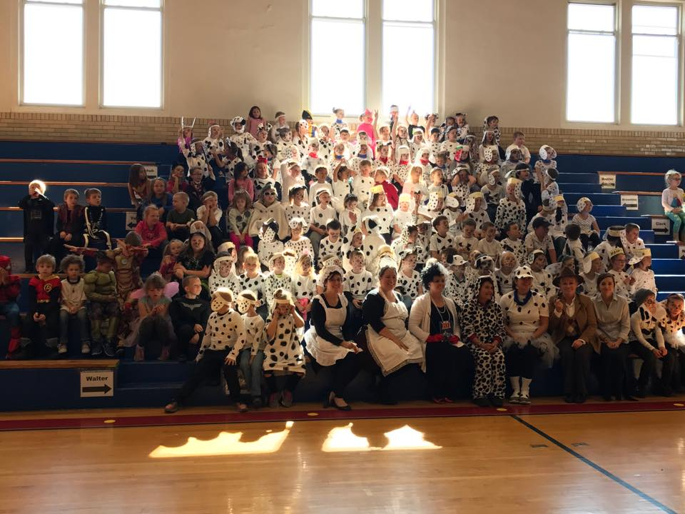 students and teachers dressed in costumes to celebrate the book 101 Dalmatians