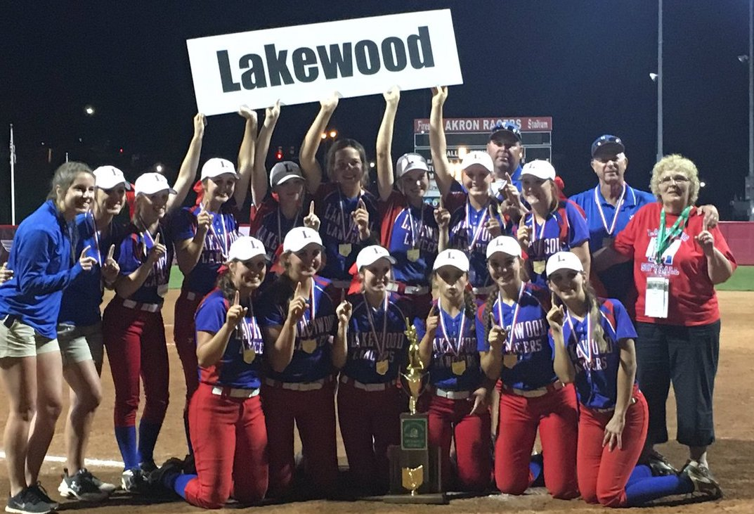 Softball team posed with state championship trophy