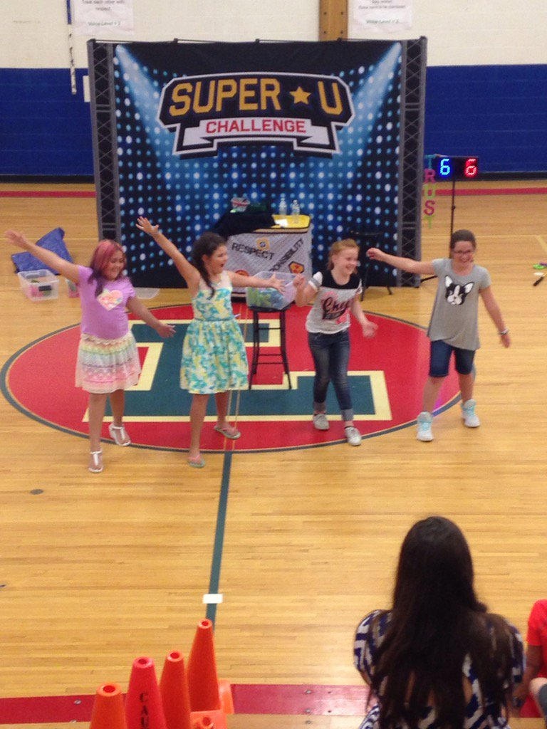 4 students performing during the Super U assembly