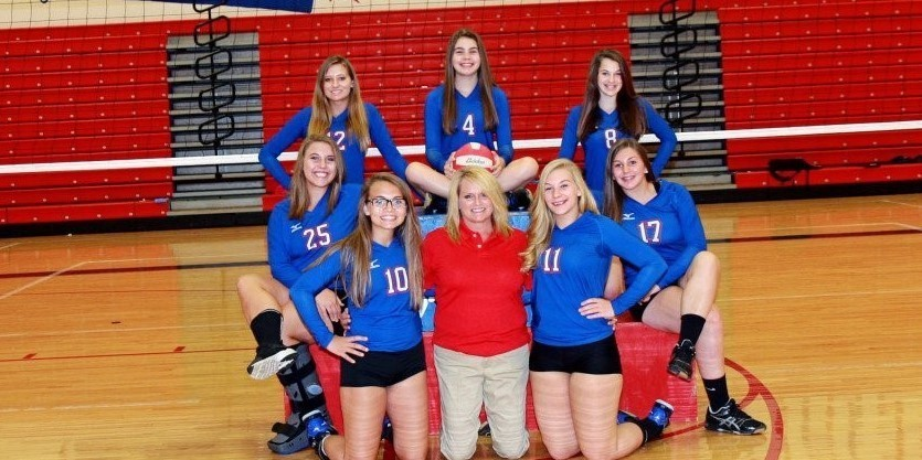 picture of JV Volleyball team and coach