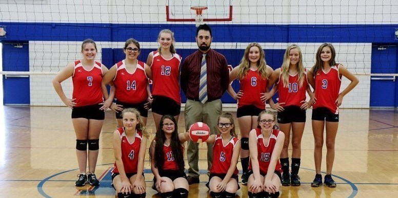 7th grade girls volleyball team and coach
