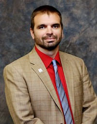 Board Member Nathan Corum