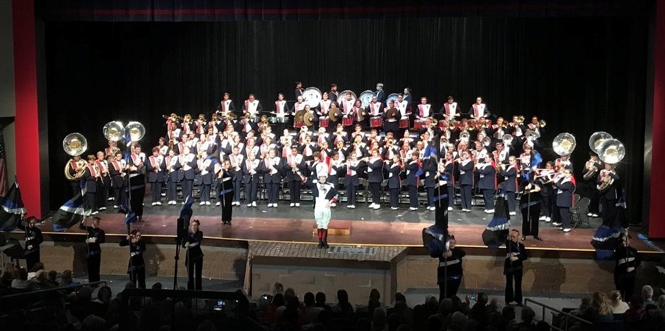 marching band on stage in the auditorium