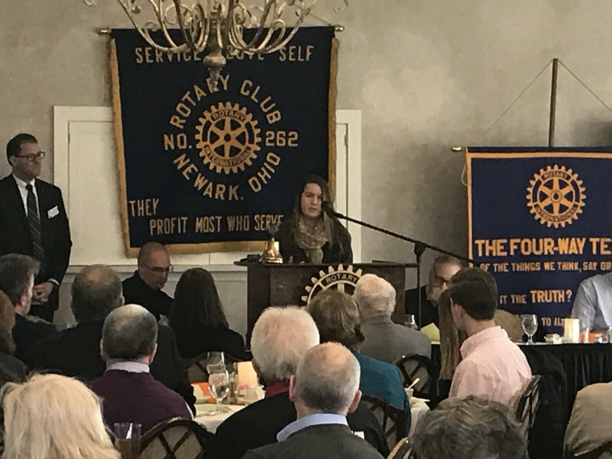 student speaking at Rotary