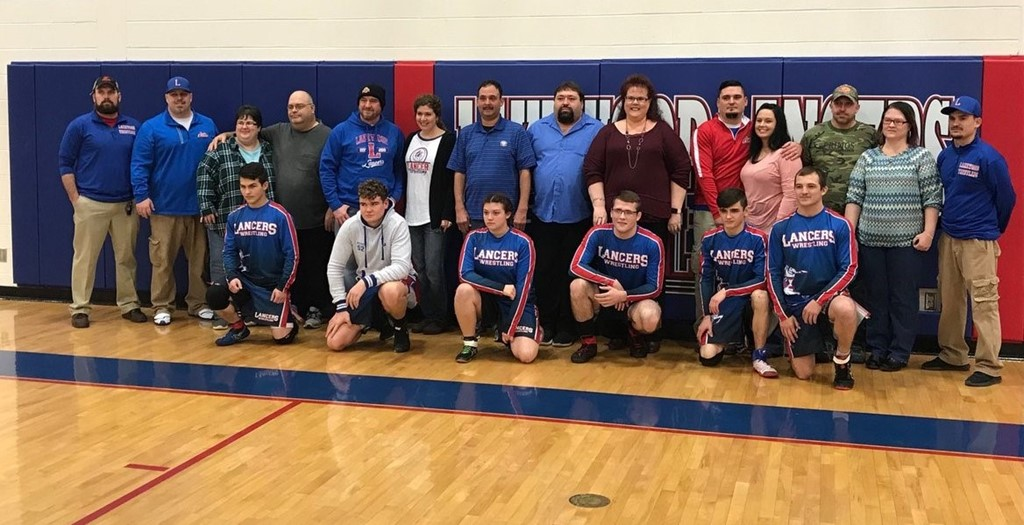 wrestlers and parents posing together