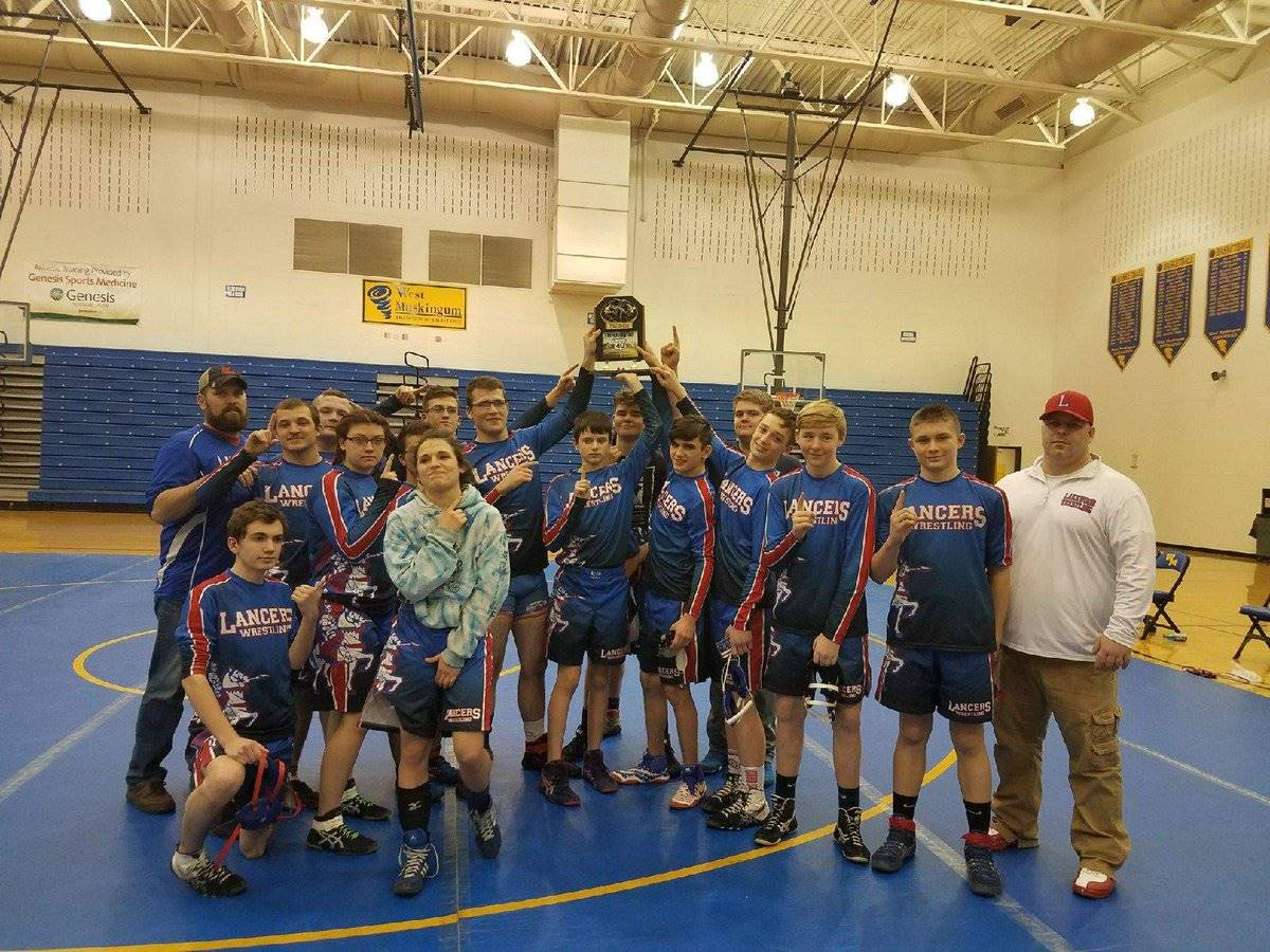 "Wrestlers bring home the ""War on 40"" Trophy"
