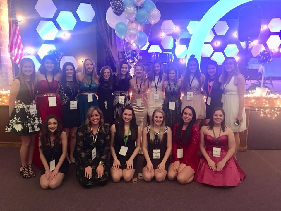 Cheerleaders volunteer at A Night to Shine event