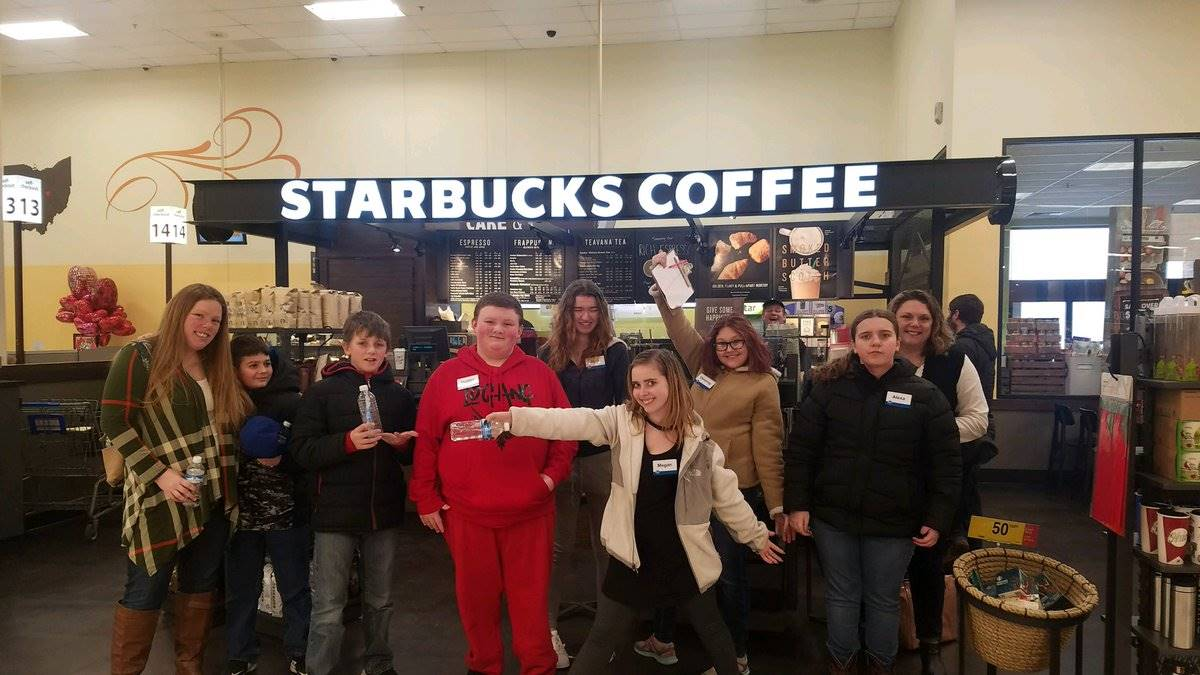 students pose in front of Starbucks in the local Kroger