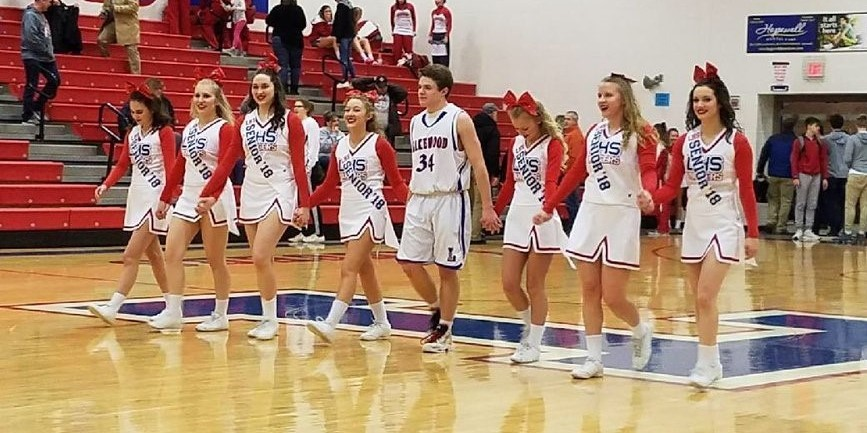 senior cheerleaders and players walking onto the court
