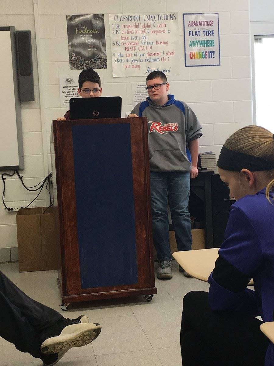 students at the podium for debates