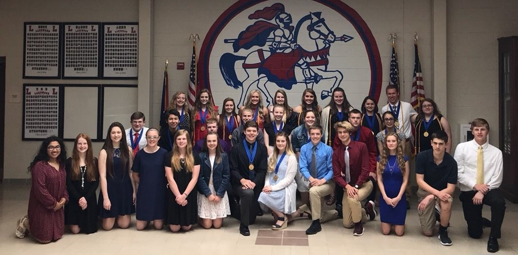 Group of students inducted into NHS posing for a photo