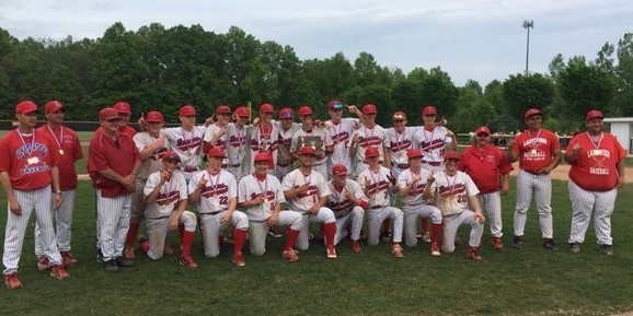 LHS Baseball team poses with district championship trophy.