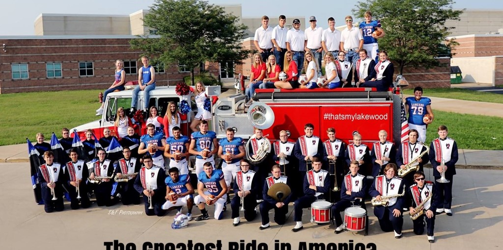 Seniors from fall sports and band posed with fire truck