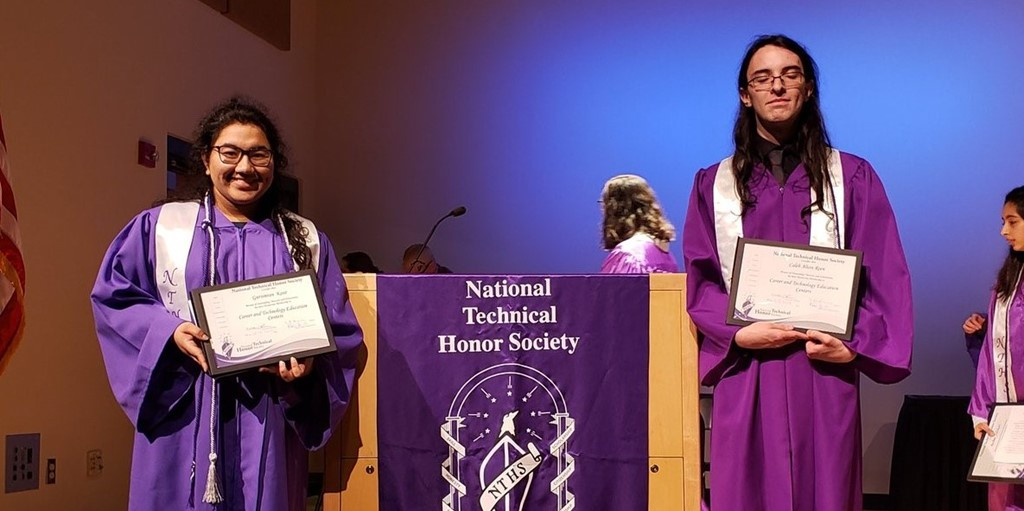 Students holding their certificates for induction into the National Technical Honor Society