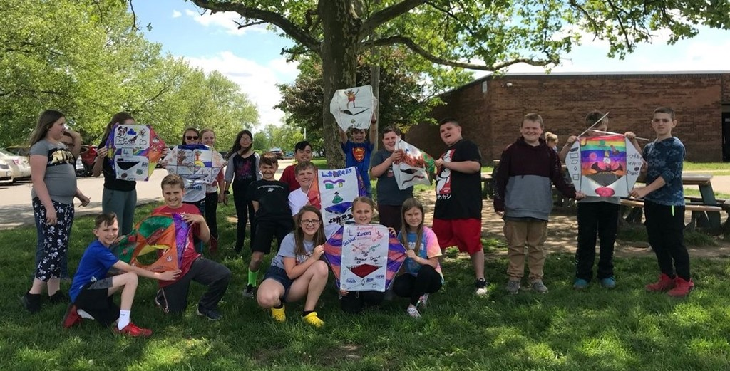 students holding kites they made